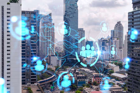 Social media icons hologram over panorama city view of Bangkok, Asia. The concept of people networking and connections. Double exposure.
