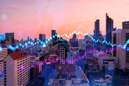 Glowing FOREX graph hologram, aerial panoramic cityscape of Bangkok at sunset. Stock and bond trading in Asia. The concept of fund management. Double exposure.