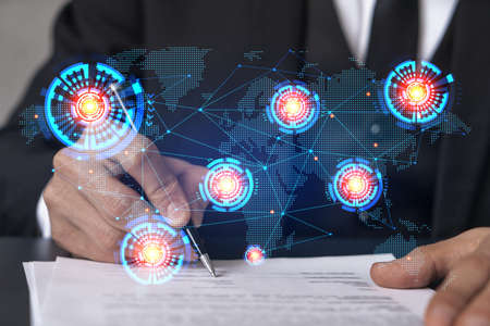 Businessman in suit signs contract. Double exposure with world map hologram. Man signing agreement international business concept. Banque d'images