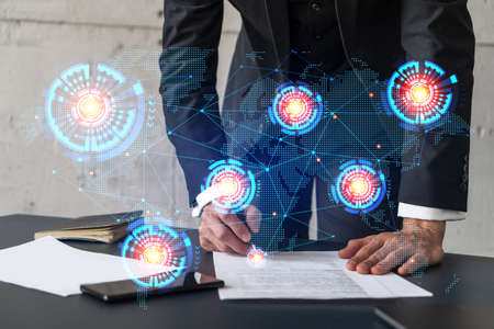 Businessman in suit signs contract. Double exposure with world map hologram. Man signing agreement international business concept.