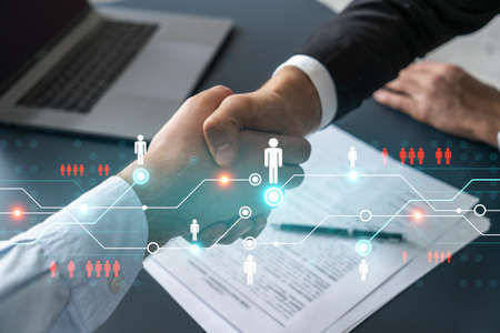 Double exposure of two businesspeople handshake and social media network icon hologram drawing background. Concept of internet connection information data. Formal wear.