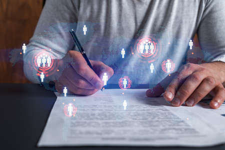 Double exposure of man signing contract and world map hologram. Concept of international business people connection.