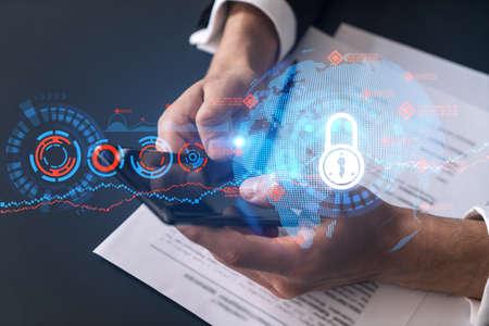 Businessman using on-line app on phone. Lock hologram. Multiexposure. Internet security concept.