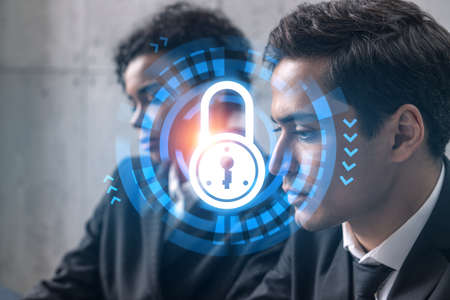 Two good looking businesspeople working on IT security project. Multiexposure. Hologram.