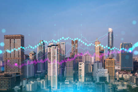 Glowing FOREX graph hologram, aerial panoramic cityscape of Bangkok at sunset. Stock and bond trading in Asia. The concept of fund management. Double exposure. Stock Photo
