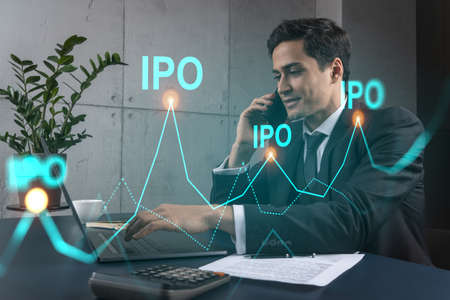 Businessman in office working with laptop technology online ipo, typing computer assemble data drawing invest concept. Double exposure.