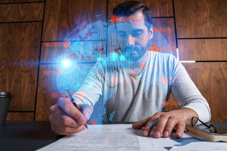 Handsome man sign intarnational contract. Multiexposure. World map hologram. Stock fotó