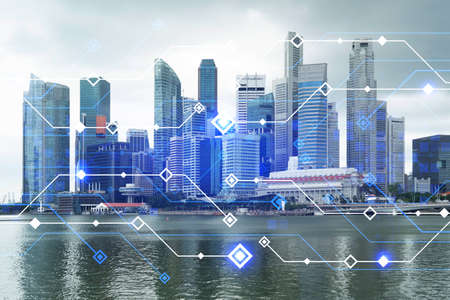 Technology hologram over panorama city view of Singapore. The largest tech hub in Asia. The concept of developing coding and high-tech science. Double exposure.