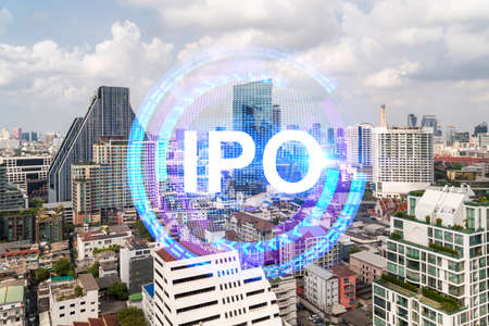 IPO icon hologram over panorama city view of Bangkok, the hub of initial public offering in Asia. The concept of exceeding business opportunities. Double exposure.