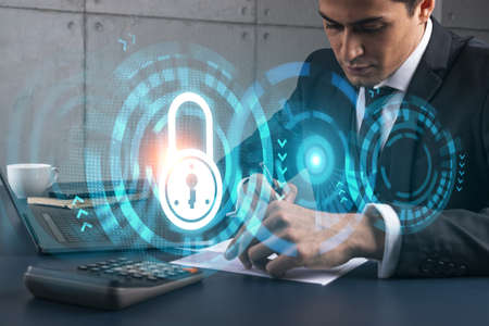 A man in office taking notes using phone and financial safety lock theme hologram. Multiexposure. Formal wear. Invest in stock market. Banque d'images