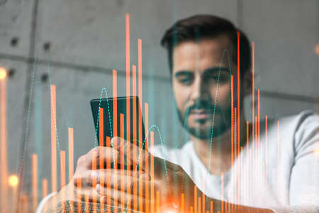A man using smart phone. Double exposure. Forex graph hologram. Financial trading on-line brokerage concept.