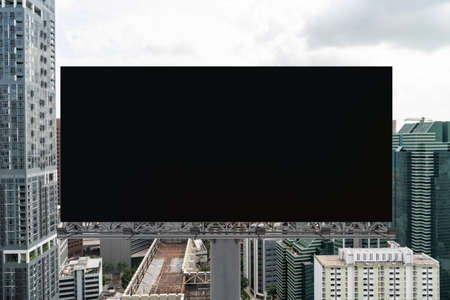Blank black road billboard with Singapore cityscape background at day time. Street advertising poster, mock up, 3D rendering. Front view. The concept of marketing communication to promote. Banco de Imagens