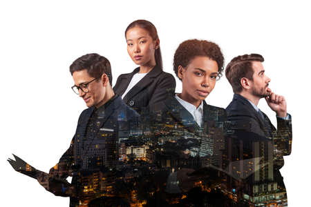 Double exposure of four young, successful, business people standing in front of Asian city Bangkok background. Concept of international teamwork together. Night time.