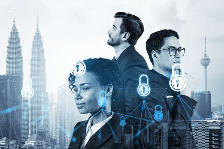 Group of business colleagues as a part of multinational corporate team working on project to protect clients information at cybersecurity compliance division. IT lock icons over Kuala Lumpur