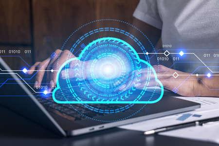 Businesswoman typing on computer in office. Cloud network illustration hologram. 版權商用圖片