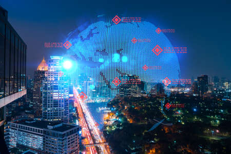 Hologram of Earth planet map on night panoramic cityscape of Bangkok, Asia. The concept of international companies. Multi Exposure.