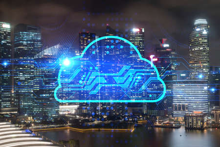 Information cloud hologram, aerial panoramic cityscape of Singapore at night. The concept of secure storing digital data in Asia. Multi exposure.