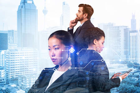 Group of business colleagues working on technology at business process to achieve tremendous growth in commerce. Worldwide process to conduct transactions. Tech hologram icons over Kuala Lumpur