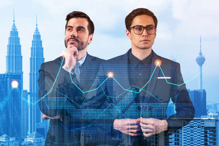 Two young handsome businessman in suits dreaming about new career opportunities after MBA graduation. Trading at corporate finance fund. Forex chart. Kuala Lumpur on background. Double exposure.