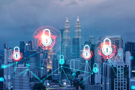 Glowing Padlock hologram, night panoramic city view of Kuala Lumpur, Malaysia, Asia. The concept of cyber security to protect KL companies. Double exposure. Banque d'images