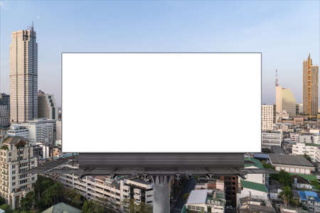 Blank white road billboard with Bangkok cityscape background at day time. Street advertising poster, mock up, 3D rendering. Front view. The concept of marketing communication to promote or sell idea.