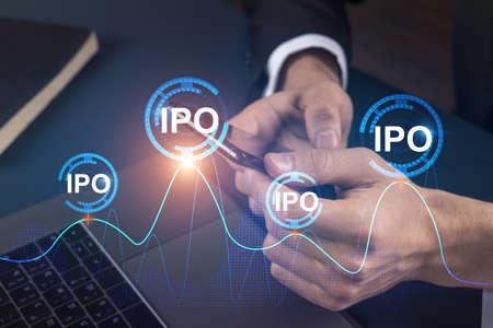 Businessman search and analyze using on-line app on phone. IPO theme hologram. Фото со стока