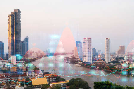 Forex and stock market chart hologram over panorama city view of Bangkok, the financial center in Asia. The concept of international trading. Double exposure. Фото со стока