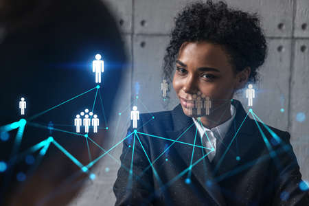 Two businesswomen work together in modern office on new project. Double exposure. Concept of success. Social network theme drawing. Stockfoto