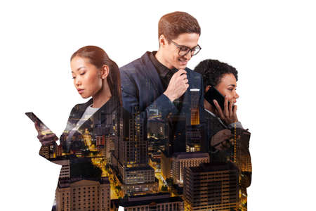 Double exposure of three young, successful, business people, man and woman, standing in front of Asian city Kuala Lumpur background. Concept of hard work and study. Modern life way. Night time.