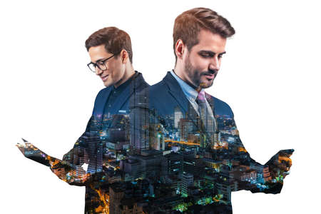 Double exposure of two young, successful, business people, man, standing in front of Asian city Bangkok background. Concept of teamwork. Night time. Imagens