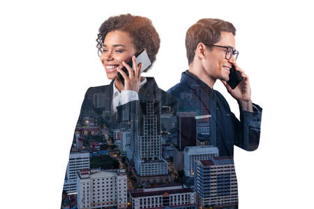 Double exposure of two young, successful, business people, man and woman, standing in front of Asian city Kuala Lumpur background. Concept of teamwork. Night time. Imagens