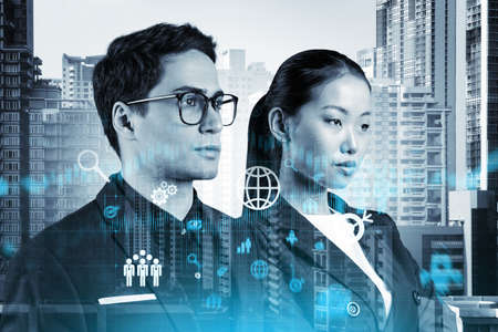 Two colleagues in multinational corporate team thinking about career opportunities at research and development department at international consulting company. Hologram icons over Bangkok. Stock fotó