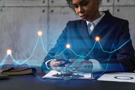 Businesswoman typing phone, work in modern office on new project. Financial graph hologram. Double exposure. Concept of success.