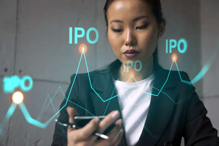 Businesswoman using phone, work in modern office on new project. IPO hologram. Double exposure. Concept of success.