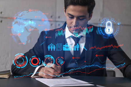 Businessman in office signs contract and business hologram. Double exposure. Formal wear. Concept of study market and analysis.