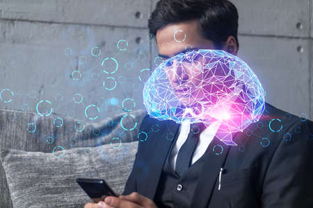 Businessman in office working with Smartphone, Brain hologram to optimize the process, typing phone. Double exposure.