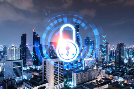 Glowing Padlock hologram, night panoramic city view of Bangkok, Asia. The concept of cyber security to protect companies. Double exposure.