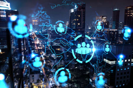 Glowing Social media icons on night panoramic city view of Bangkok, Asia. The concept of networking and establishing new connections between people and businesses. Double exposure.