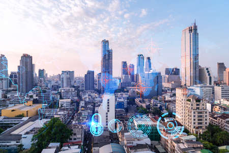 Glowing hologram of Earth planet map on aerial panoramic cityscape of Bangkok at sunset, Asia. The concept of international business. Multi Exposure.