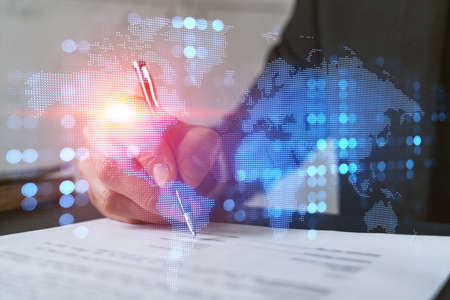 Double exposure of businessman signing contract background and world map hologram. Inernational business.