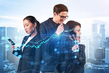 Group of business colleagues working on new venture capital and hi-tech start up and try to forecast risks and estimate prospective earning growth. Hologram chart on Singapore background. Imagens