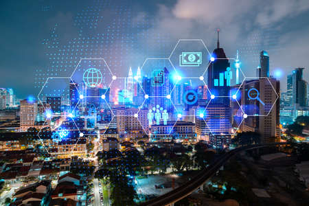 Research and technological development glowing icons. Night panoramic city view of Kuala Lumpur. Concept of innovative activities expanding new services or products in Malaysia, Asia. Double exposure.