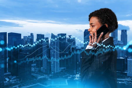Attractive black businesswoman trader processing conference call to forecast the capital market behavior. Concept of trading strategy. Forex chart. Singapore. Double exposure.
