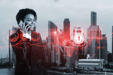 Attractive black businesswoman developer having conference call to protect clients confidential information by inventing solutions. IT lock icons over Singapore city background.