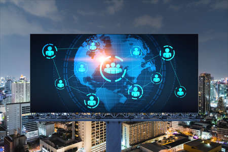 World planet Earth map hologram and social media icons on billboard over night panoramic city view of Bangkok, Southeast Asia. Networking and establishing new connections between people. Globe