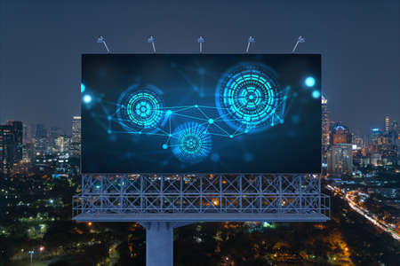 Information flow hologram on road billboard, night panorama city view of Bangkok. The largest technological center in Southeast Asia. The concept of programming science.