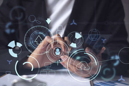 Businesswoman in formal wear checking the phone to sign the contract to create a software to present it at start up conference and gain investments for innovative service. Hologram tech graphs.