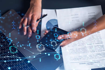 Woman hands typing the keyboard to create innovative software to change the world and provide a completely new service. Close up shot. Hologram tech graphs. Concept of Dev team. Casual wear. Stock fotó
