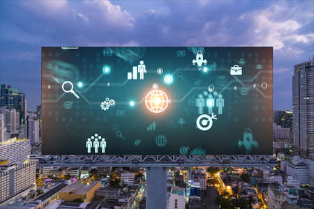 Research and technological development glowing icons on billboard. Night panoramic city view of Bangkok. Concept of innovative activities expanding new services or products in Southeast Asia.
