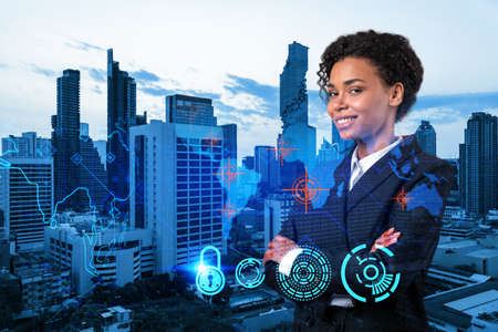 Successful smiling black businesswoman is thinking about new concepts at cybersecurity compliance division to protect clients confidential information. IT lock icons over Bangkok background. Foto de archivo